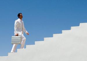 Businessman Walking up Stairs --- Image by © Estelle Klawitter/Corbis