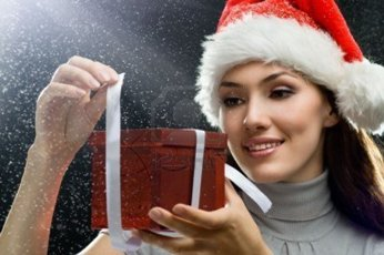 5582813-young-girl-with-christmas-present-in-hands
